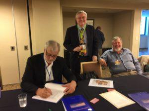 Frank signs Bob Leonard's book